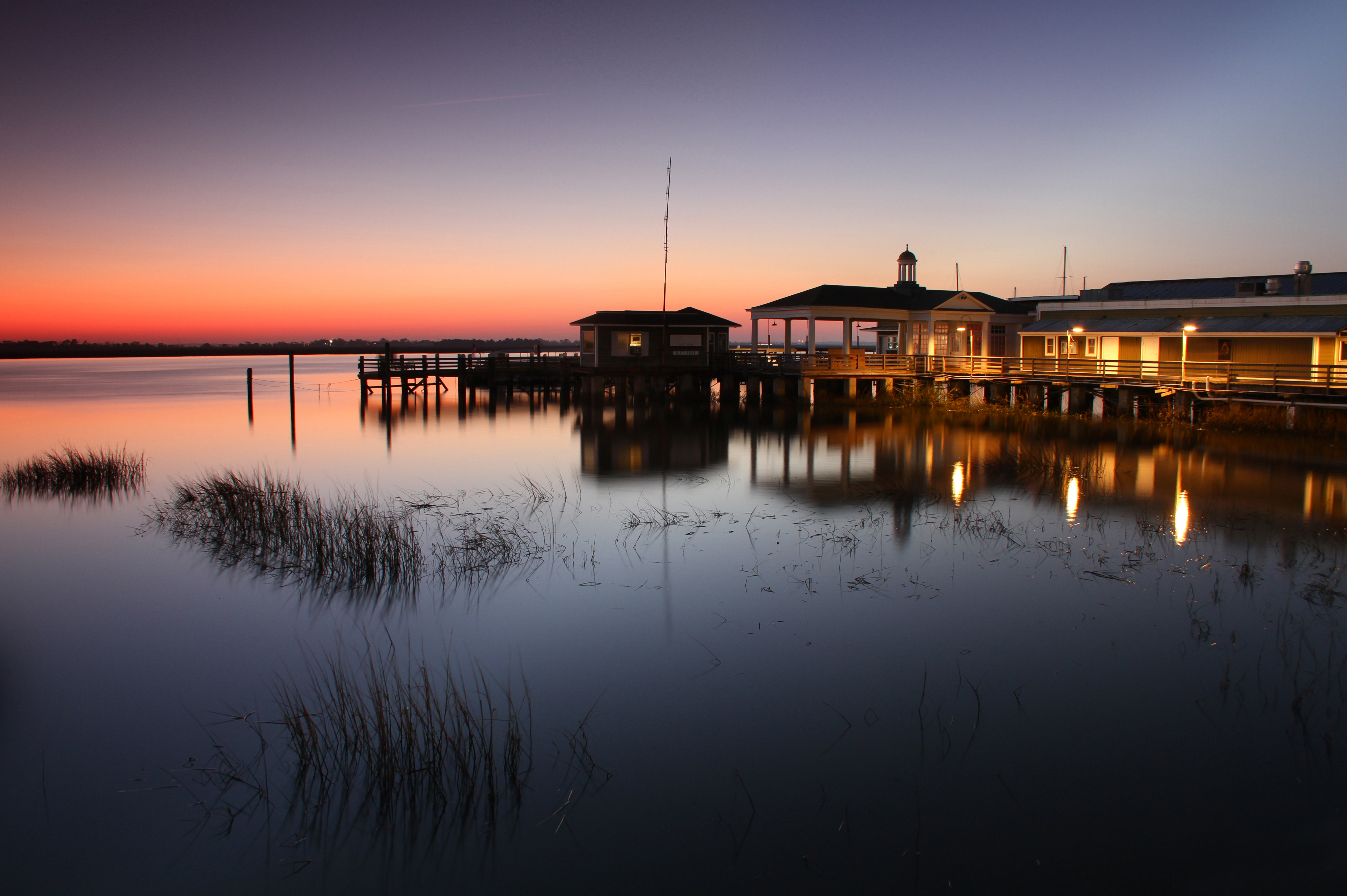 Pier and building at dusk on Jekyll Island, Georgia.